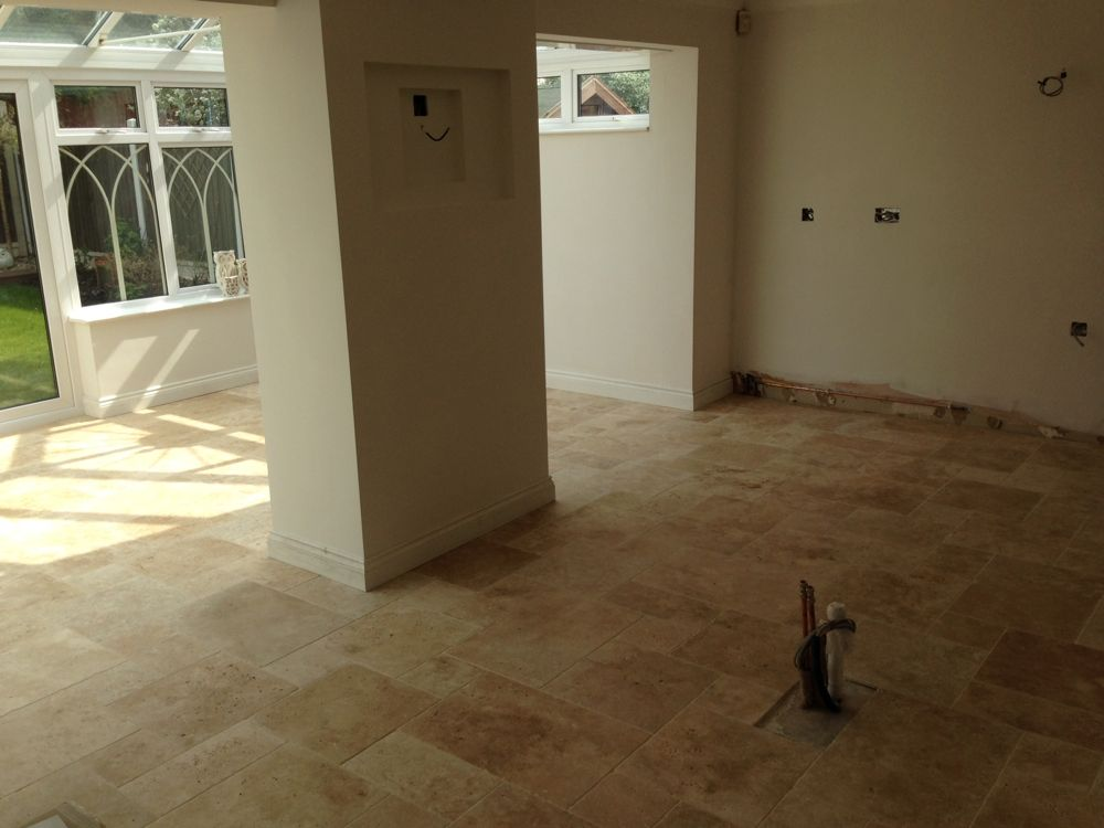 Stone flooring laid, skirting boards in place and fitting out started