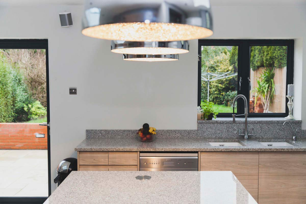 Light, spacious kitchen area overlooks new patio