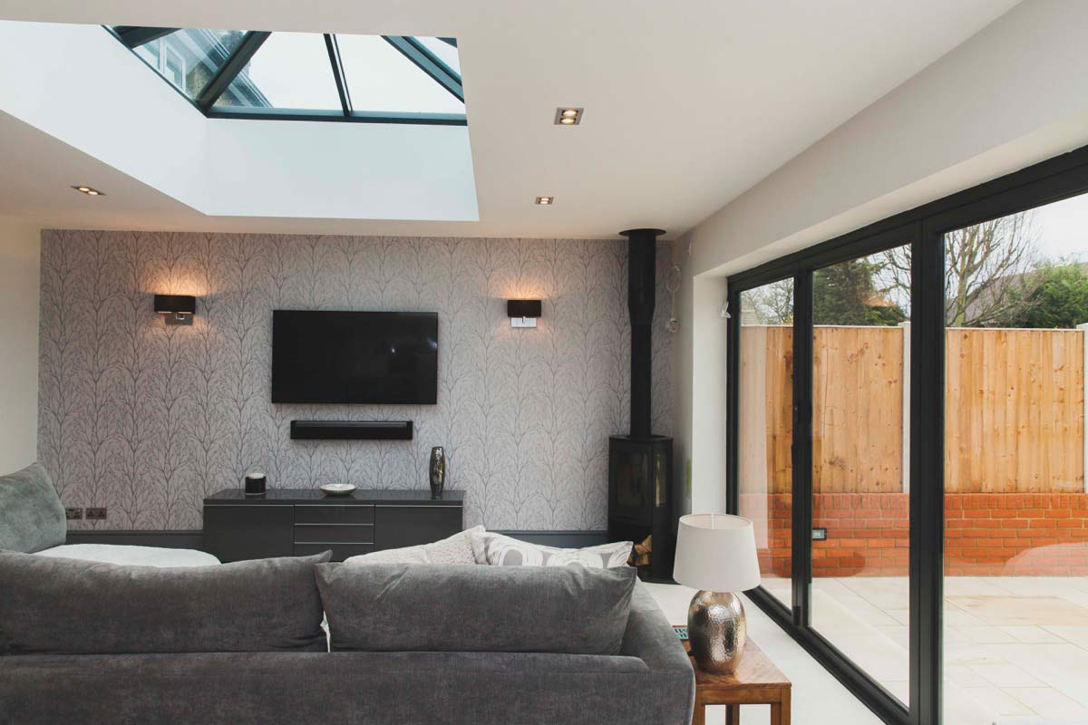 The family room benefits from natural light and opens onto the garden