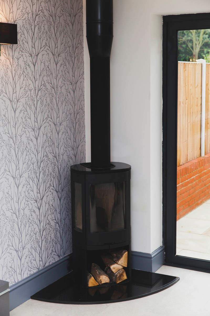 carefully chosen fittings like this log burner are practical as well as beautiful