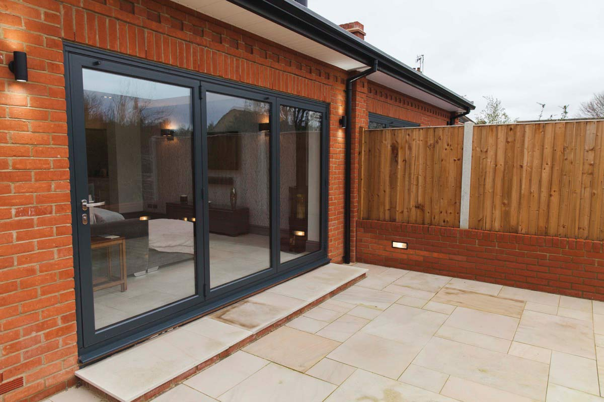 Image of B-fold doors open onto a new patio
