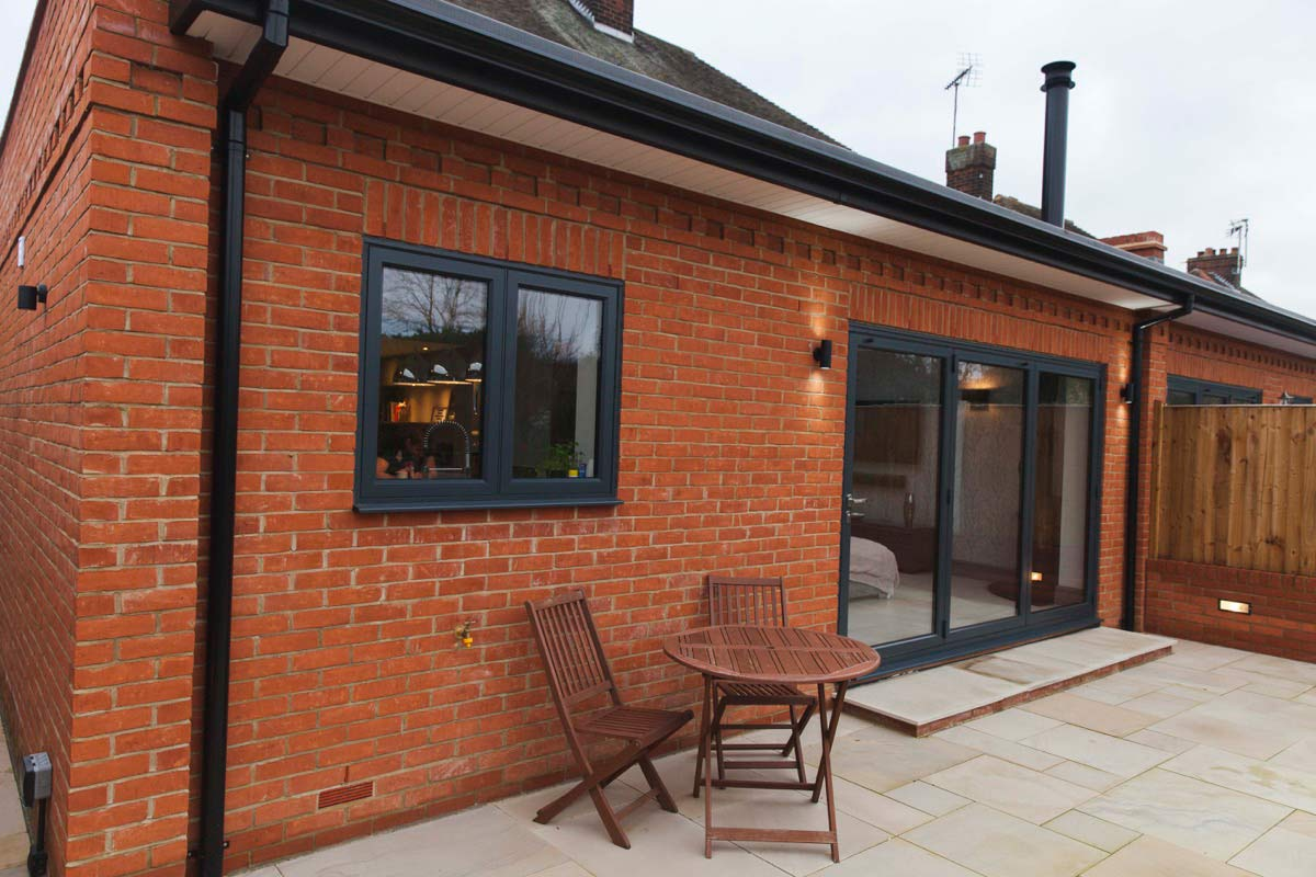 B-fold doors open onto a new patio