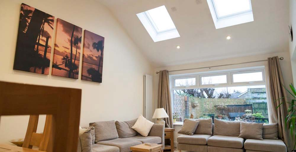 Extension in Galleywood: This unusual room was created in line with the customer's designs and ideas to extend their property in Galleywood, Essex and make additional, comfortable space for family living.  The line of the pitched roof was followed to give maximum height and an airy feel to the space.