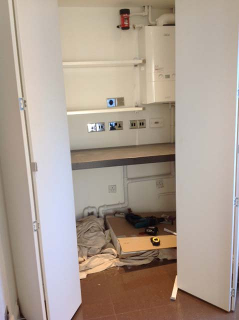 Image of The utility room is finished and sits neatly behind its folding screen