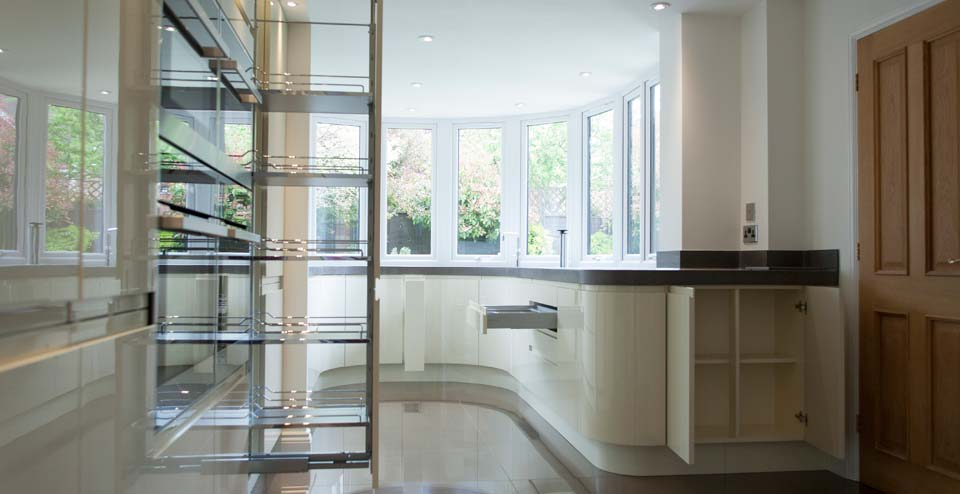Great Notley Kitchen: The owners of this house in Great Notley have used CWN Developments Ltd for a number of projects over the years.  This one was to extend the rear of the property with a curved bay, then design and install a new kitchen in the space.  They wanted something out of the ordinary.