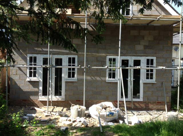 Image of The windows and exterior doors are being fitted, then we can get on with the inside.