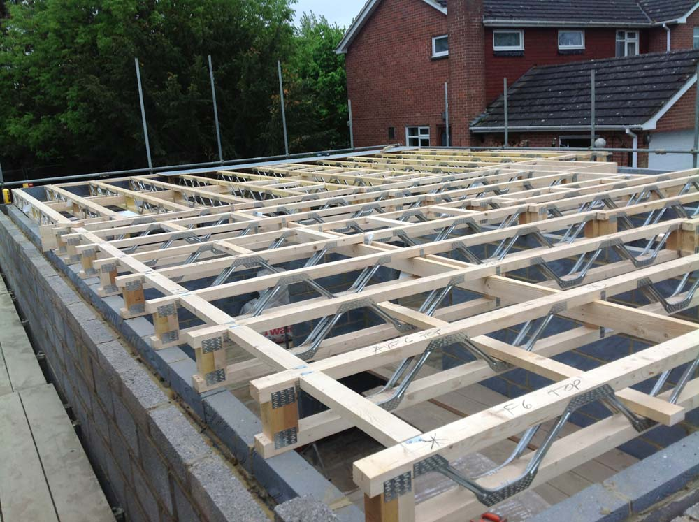 Image of The blockwork has now gone up far enough for the fitting of first floor joists.  Next stop: Roof trusses!