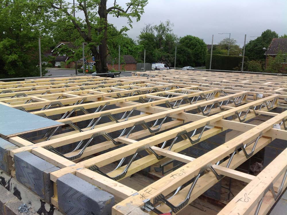 The blockwork has now gone up far enough for the fitting of first floor joists.  Next stop: Roof trusses!